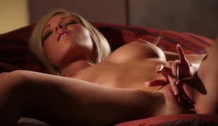 This glamour porn video is all about mouth-watering blonde Niki Lee Young with sexy titties finger fucking her neatly shaved snatch with her slim legs apart in the semi-dark of the room.
